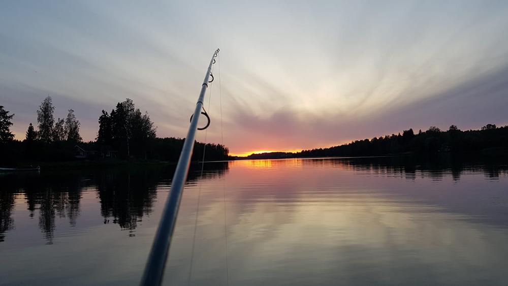 seeterin kartanon kalastus mahdollisuudet kuva ongesta ja auringon laskusta